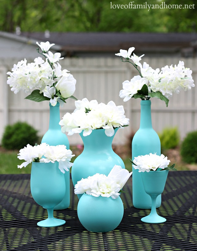 Easy & Inexpensive Centerpieces - upcycle old wine bottles & glassware with a little spray paint to create elegant & fun table decor